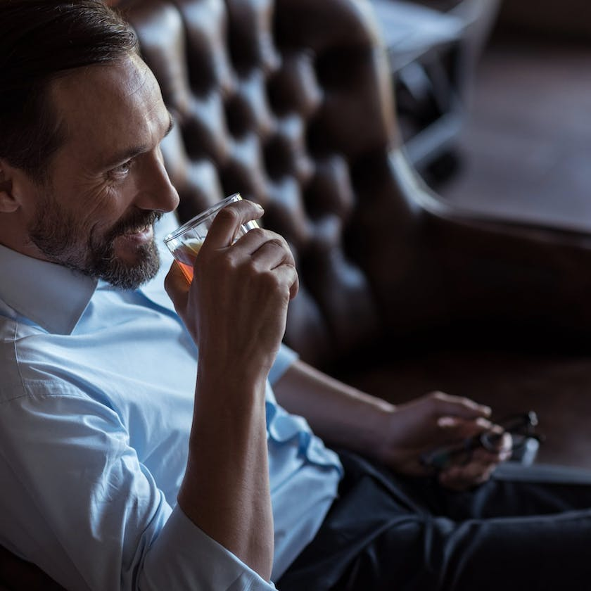 Man drinking whiskey from a glass